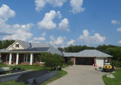 Metal Roof House and Garage Long Driveway